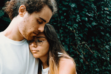 woman rests her head on a man shoulder