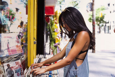woman sifts through record sale
