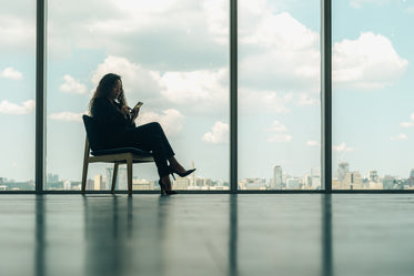 Browse Free HD Images of Woman Sitting On Phone In Modern Office Chair