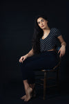 woman sitting on wooden chair