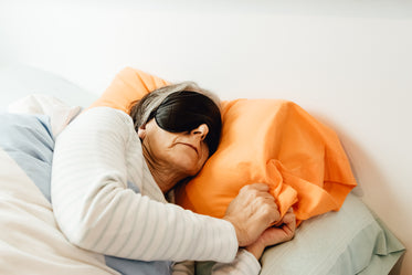 woman sleeping with a mask covering her eyes