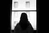 woman standing at window