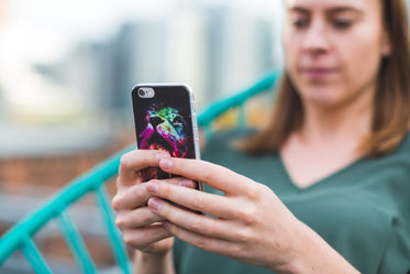 woman using smart phone with case