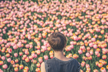 woman viewing tulips