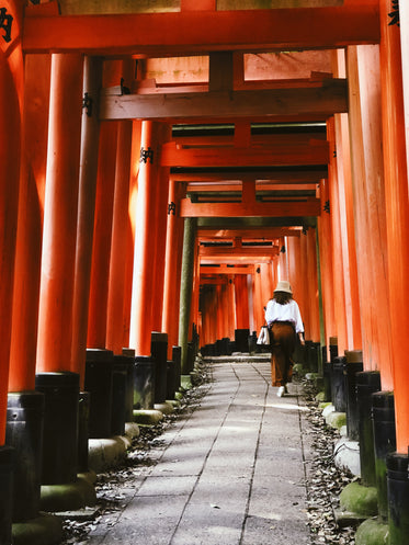 woman walks up a historical japanese path