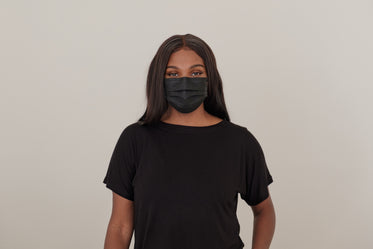 woman wearing a black dispoable face mask
