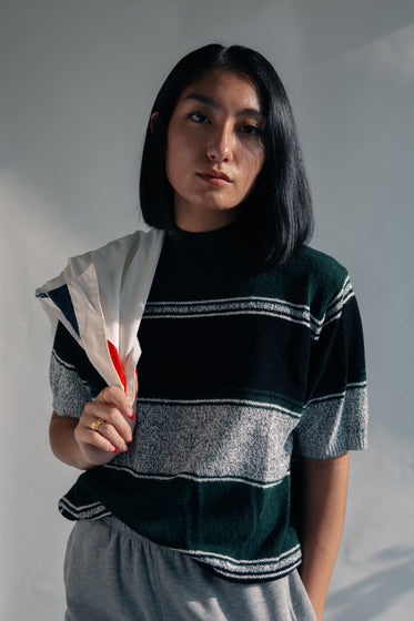 woman wearing grey and green sweater
