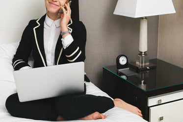woman with laptop in hotel