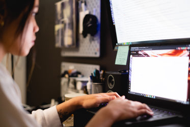woman works on bright computer screens
