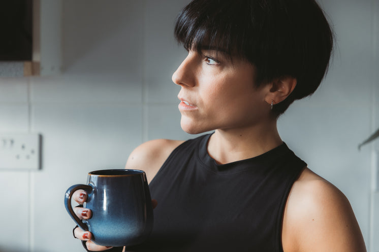 Women Holds A Mug And Looks To The Left