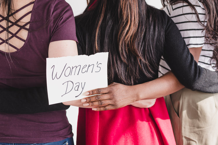 women-linking-arms-in-celebration-of-wom