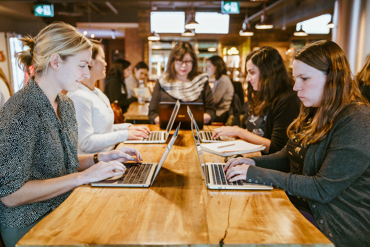 Women On Laptops Around Table