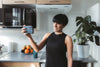 women stands in the kitchen and takes a selfie