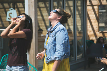women watch eclipse