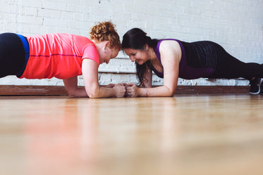 women who plank together