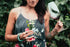 women's fashion tattooed woman holding flowers and wine