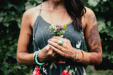 Browse Free HD Images of Women's Fashion Tattooed Woman Holding Flowers