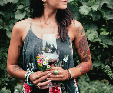 women's fashion tattooed woman stood in vineyard