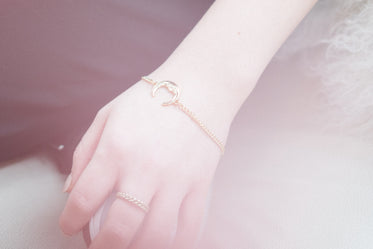 woman's hand with charm bracelet
