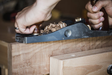 wood curls on a hand plane