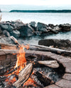 wood fire on a cold day by the water