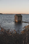 wooden cabin on a lake