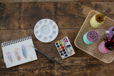 wooden craft table set up for watercolors