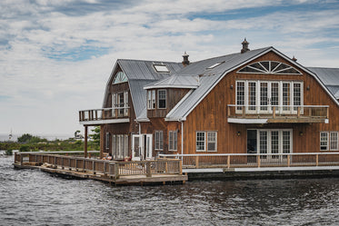 wooden house at waters edge
