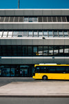 yellow bus parks in the big city
