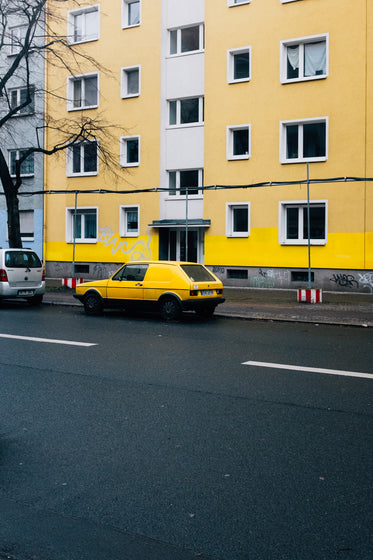 yellow car and building