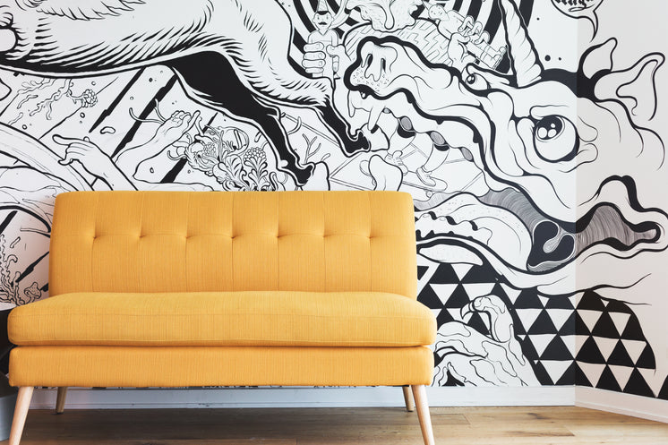 Yellow Couch By Black And White Mural