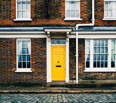 Picture of Yellow Door On Brick Home — Free Stock Photo