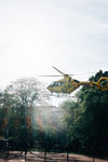 yellow helicopter lands in town