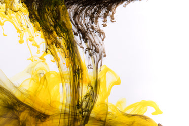 yellow ink with black drops