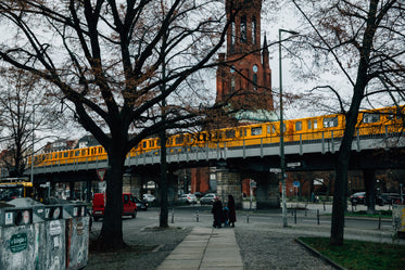 yellow subway train over downtown