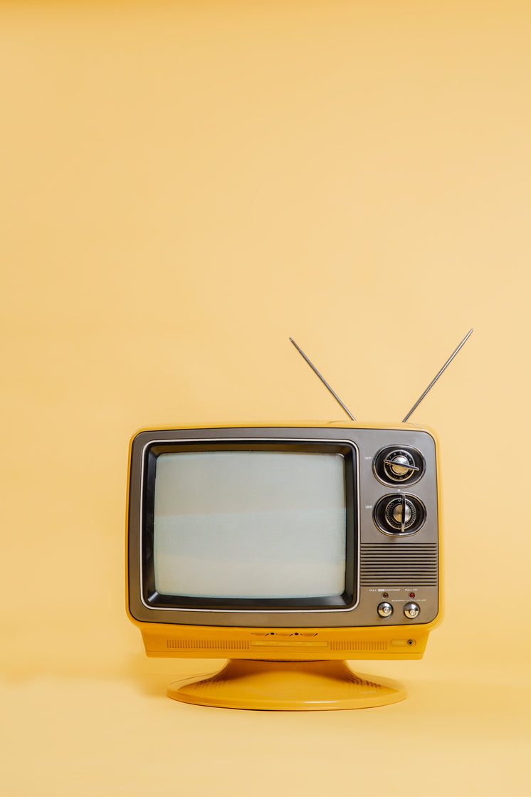 Yellow TV Set On Monochromatic Seamless Backdrop