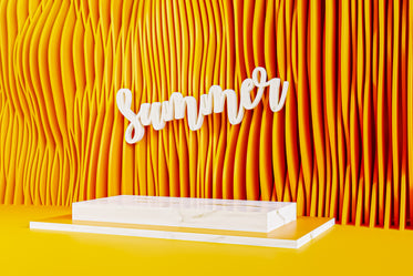 yellow wall with lines and a white sign saying summer