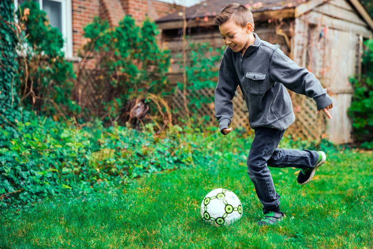 Young Boy Kicking Ball