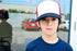 young child in ball cap