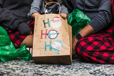 young family opens christmas gifts together