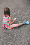 young girl drawing hopscotch