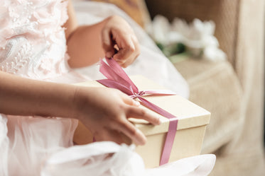 young girl opening gift