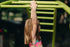 young girl swinging on bars