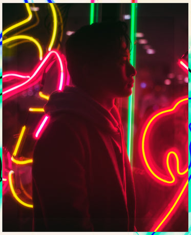 young man in neon lights