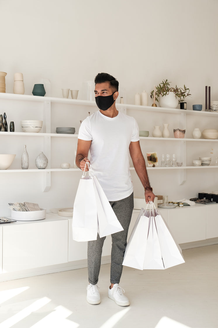 Young Man Leaves Store With Shopping