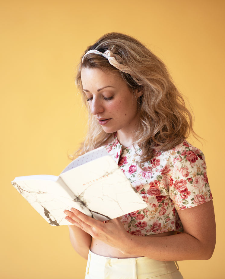 Young Woman Checking Her Notes
