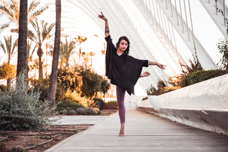 Young Woman Dances With Nature