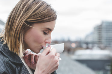 Picture of Young Woman Drinking Tea - Free Stock Photo