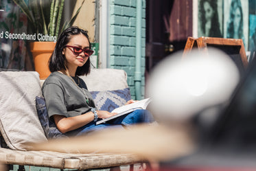 young woman enjoying a book in the sun