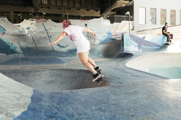 young woman in pink skating a bowl
